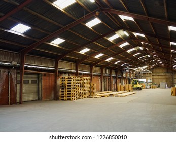 Inside agriculture farm strorage warehouse with pallets and a fork lift