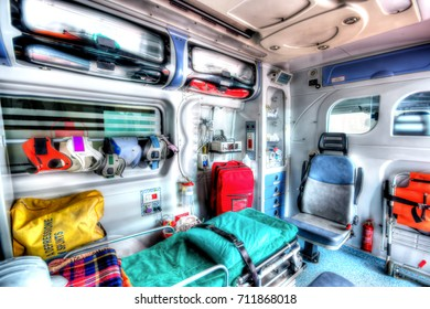 Inside the ambulance, view from the sanitary compartment. Different medical equipment and a stretcher. Selective focus.