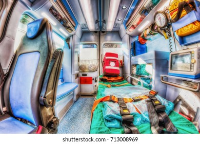 Inside the ambulance, view from the sanitary compartment. Different medical equipment and a stretcher. HDR  dark version.