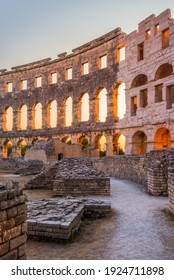 Inside of Ancient Roman Amphitheater in Pula, Croatia, Famous Travel Destination, in Sunny Summer Evening