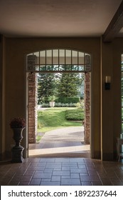 Inside of antique entrance arch with flower vase and front garden