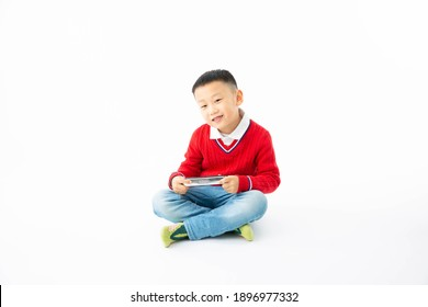 Inside, a boy with a white background holds a harmonica