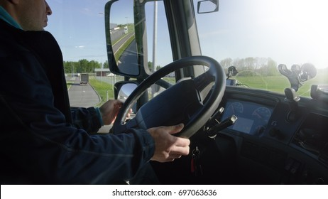Inside of the Cabin View of the Professional Truck Driver Driving His Big  Vehicle on the Road.
