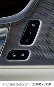 inside car door lock buttons and driver seat memory buttons
