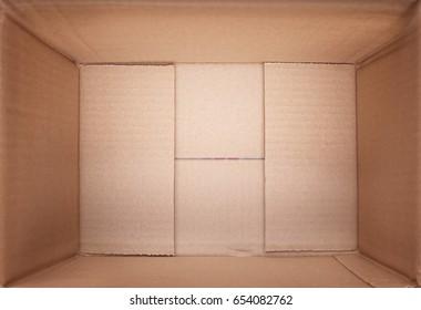Inside a cardboard packaging box