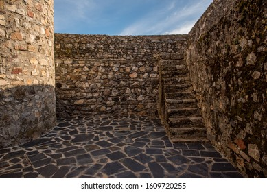 Inside Marvão castle with bricks and mortar walls and stairs