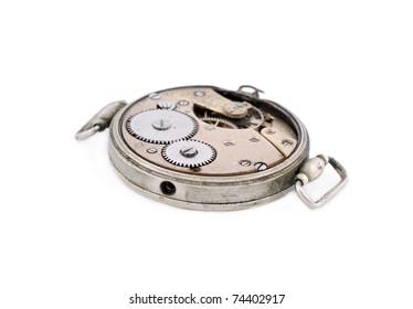 Inside the clock (watchwork), antique vintage clock mechanism