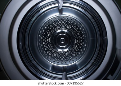 Inside of a clothes dryer showing metal circles.