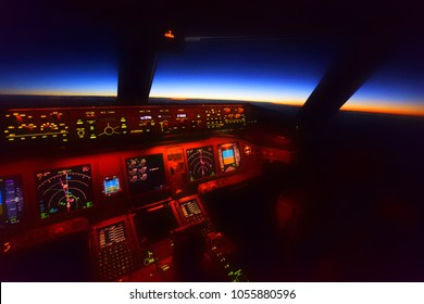 Inside cockpit view during sunrise over the sea