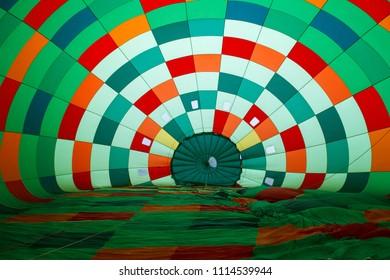 inside in a coloful hot air balloon