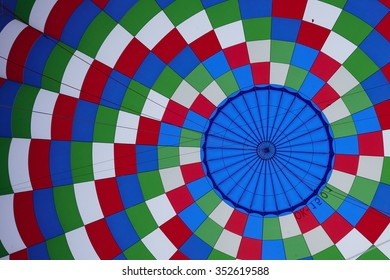 inside of a colorful hot air balloon as it is inflated for flight