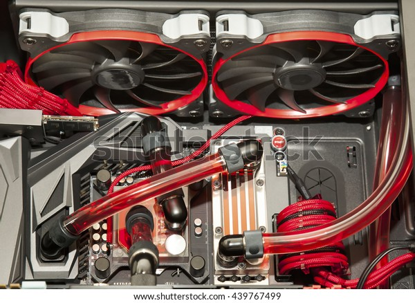 Inside computer water cooling  system in red background