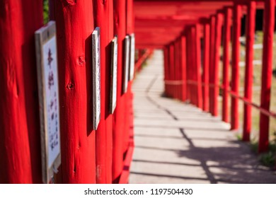 Inside a curving tunnel of 123 red gates at Motonosumi Inari Shrine in Yamaguchi Prefecture, Japan