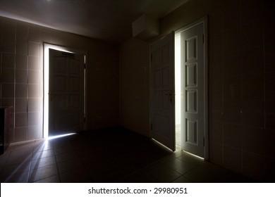 Inside a dark room with half-opened doors