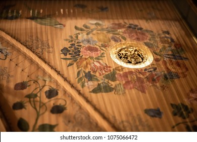 Inside decoration of a harpsichord in a church in Seville Spain