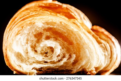 Inside Details of Buttery and Flaky Delicious Homemade Croissant Bread in Close up, Isolated on Black Background.