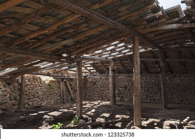inside a dilapidated barn