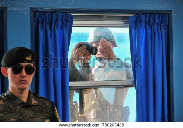 Inside the DMZ, there is the Joint Security Area (JSA), South Korea - April 3, 2017: North Korean soldiers are filming inside Panmunjom in the Joint Security Area.