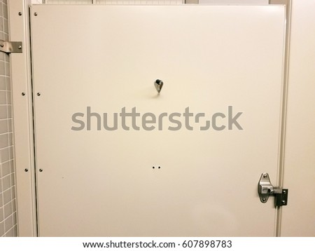 inside of door in bathroom stall