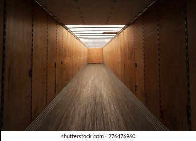 Inside empty cargo container.