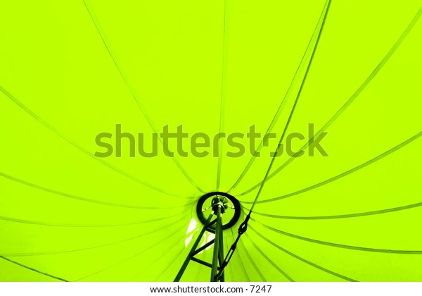 inside an exposed lime-green umbrella