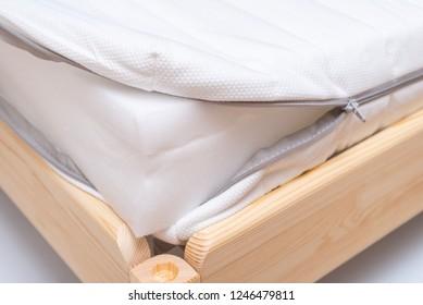 Inside of foam mattress on wooden bed