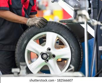 Inside a garage - changing wheels-tires