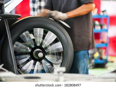 Inside a garage - changing wheels-tires/Auto Mechanic changing car tire with wheel machine/Preparing to change the tires in the garage into car maintenance shop.Wheel maintenance.