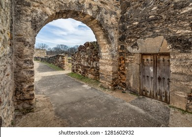 Inside the gate at Mission San Juan Capistrano in San Antonio, Texas. The wooden doors were to the gatekeeper's quarters in this mission established here in 1731.