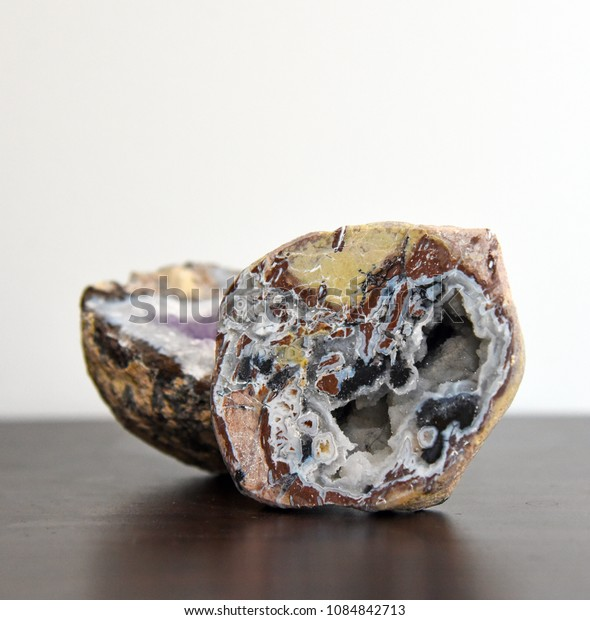 Inside of geode agate rock on table