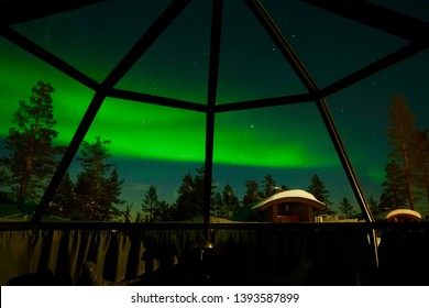 Inside glass Igloo. Laid in warm bed to see Aurora Borealis glowed across the sky of Arctic.
