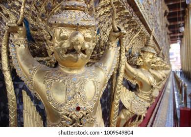 inside a golden wat in Bangkok