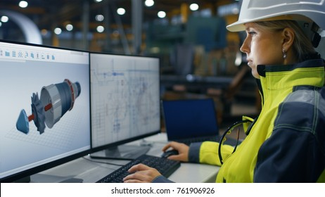Inside the Heavy Industry Factory Female Industrial Engineer Works on the Personal Computer on the Turbine/ Engine Project in 3D Using CAD Program.