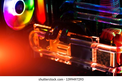 Inside a high performance computer. Computer circuit board and CPU cooling fans illuminated by internal LEDs inside a server class computer.