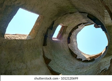 Inside the hollowed-out shell of a tower at the Madenburg castle ruin in Landau in der Pfalz, Germany.
