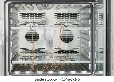 Inside of incubator with thermocouple probes installed for calibtlration in laboratory.