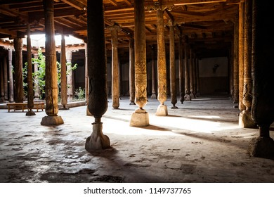 Inside Juma (Friday) Mosque in Khiva, Khorezm Region, Uzbekistan. Huge ancient wooden columns with carvings and mysterious light