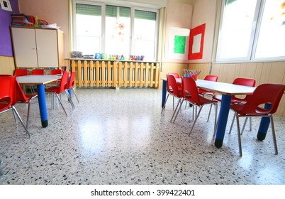 inside kindergarten with desks and small red chairs