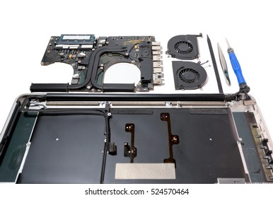 inside laptop computer with fan mainboard and tools