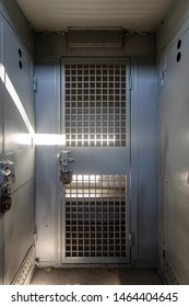 Inside of a large bus used by police to transport prisoners for public safety
