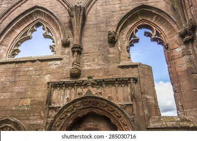 Inside of Lincluden Collegiate Church (also know as Priory or Abbey) in Dumfries. Close up on windows with blue sky showing through.