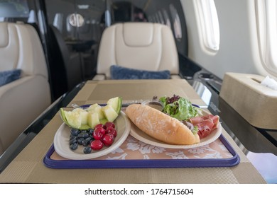 inside a luxury business jet with deligoues food prepared for the VIP passengers