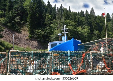 Inside marina of St. Martins commercial fishing boat and lobster traps waiting the lobster fishing season in the area to be restarted