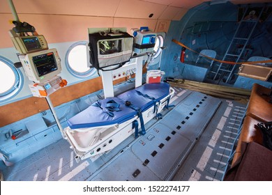 Inside of medical helicopter with emergency life support equipment. Interior of the medical helicopter, indoors.  The inside of a medical helicopter is filled with emergency life support equipment.