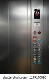 Inside the metal elevator floor selection buttons. Element of design.