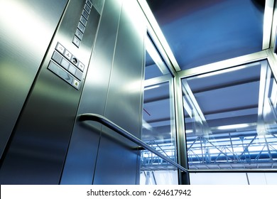 Inside metal and glass Elevator in modern building , the shiny buttons and railings