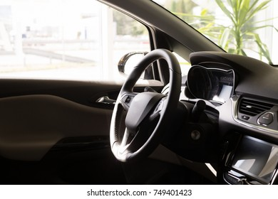 Inside a modern car, view on a steering wheel and console, modern car interior