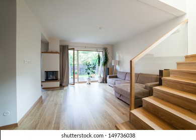 Inside of a modern house with minimal furniture