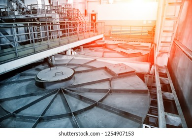 Inside modern wastewater treatment plant. Closed sewage reservoir with dirty water.