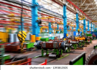 Inside Moving Assembly Line of the Large industrial shop truck plant. Bridge Crane Hook against the background of the industrial factory. Manufacturing Facilities. Motion blur effect